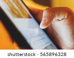 image of hand using digital... | Shutterstock . vector #565896328