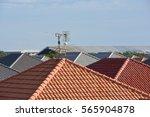 radio antenna on the roof of... | Shutterstock . vector #565904878