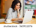 woman sitting at cafe with...   Shutterstock . vector #565911076
