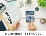 accountant verify the saving... | Shutterstock . vector #565947730