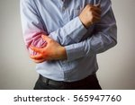 man suffering from elbow joint... | Shutterstock . vector #565947760