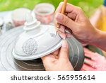 thai woman who painted design... | Shutterstock . vector #565955614