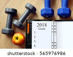 dumbbells with apple and open... | Shutterstock . vector #565976986