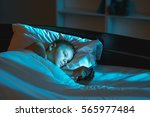 the boy lie on the bed and phone | Shutterstock . vector #565977484