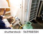 technician is checking air... | Shutterstock . vector #565988584