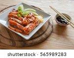 peking duck is served on a...   Shutterstock . vector #565989283