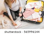 pregnant woman packing for... | Shutterstock . vector #565996144