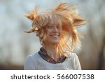 the wind plays with the hair of ... | Shutterstock . vector #566007538