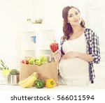 beautiful pregnant woman with... | Shutterstock . vector #566011594