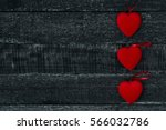 Red Hearts On Dark Wooden Table....