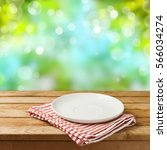 empty white plate on wooden... | Shutterstock . vector #566034274