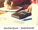 woman hand calculate about... | Shutterstock . vector #566034430