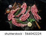 raw fresh lamb meat and fork on ... | Shutterstock . vector #566042224