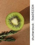 Small photo of Kiwi in the context with a sprig of rosemary
