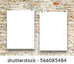 Two Blank Frames Hanged By...