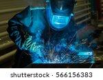 worker using torch cutter to... | Shutterstock . vector #566156383