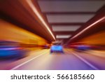 cars quickly go in lit tunnel | Shutterstock . vector #566185660