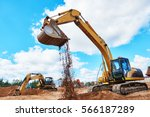 excavator at sandpit during... | Shutterstock . vector #566187289