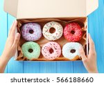 female hands holding box with... | Shutterstock . vector #566188660