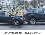 Small photo of Car accident on the city road slippery