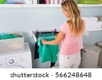 Woman Hanging Wet Clean Cloth...