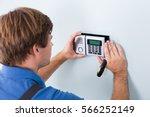 young male technician... | Shutterstock . vector #566252149