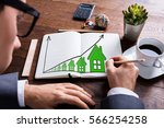 close up of businessman drawing ... | Shutterstock . vector #566254258
