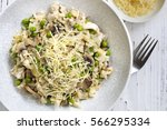 risotto with mushrooms and peas ... | Shutterstock . vector #566295334