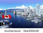 Stock photo canadian flag in front of view of false creek and the burrard street bridge in vancouver canada 566300428