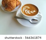Latte Art Coffee And Croissant...