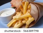 french fries in a paper bag | Shutterstock . vector #566389798