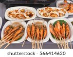 bbq king prawns and scallops at ... | Shutterstock . vector #566414620
