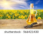 sunflower oil in glass bottle... | Shutterstock . vector #566421430