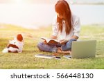 woman reading book at public... | Shutterstock . vector #566448130