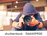 photographer focusing on... | Shutterstock . vector #566449900