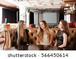 young friends in a cafe | Shutterstock . vector #566450614
