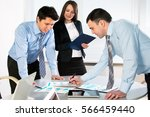 group of business people at a... | Shutterstock . vector #566459440