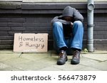 Homeless And Hungry Man Sitting ...