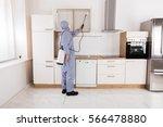 pest control worker in workwear ... | Shutterstock . vector #566478880