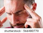 man that seems to suffer a... | Shutterstock . vector #566480770