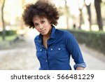 young black woman with afro... | Shutterstock . vector #566481229