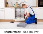 young repairman service worker... | Shutterstock . vector #566481499