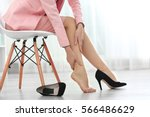 woman suffering from leg pain... | Shutterstock . vector #566486629