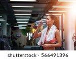 girl drinking water in gym... | Shutterstock . vector #566491396