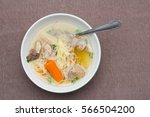 chicken soup on plate | Shutterstock . vector #566504200