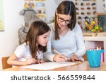 Small photo of Teacher Mom working with Creative Kid