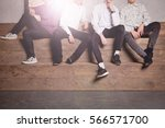 young boys sitting on large... | Shutterstock . vector #566571700