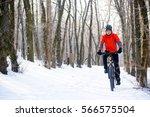 mountain biker riding bike on...   Shutterstock . vector #566575504