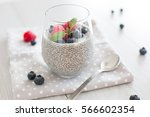 healthy chia pudding with... | Shutterstock . vector #566602354