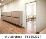 lockers in empty school hallway | Shutterstock . vector #566603314